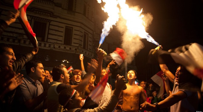 Crowds cheer joyfully in central Cairo, Egypt.